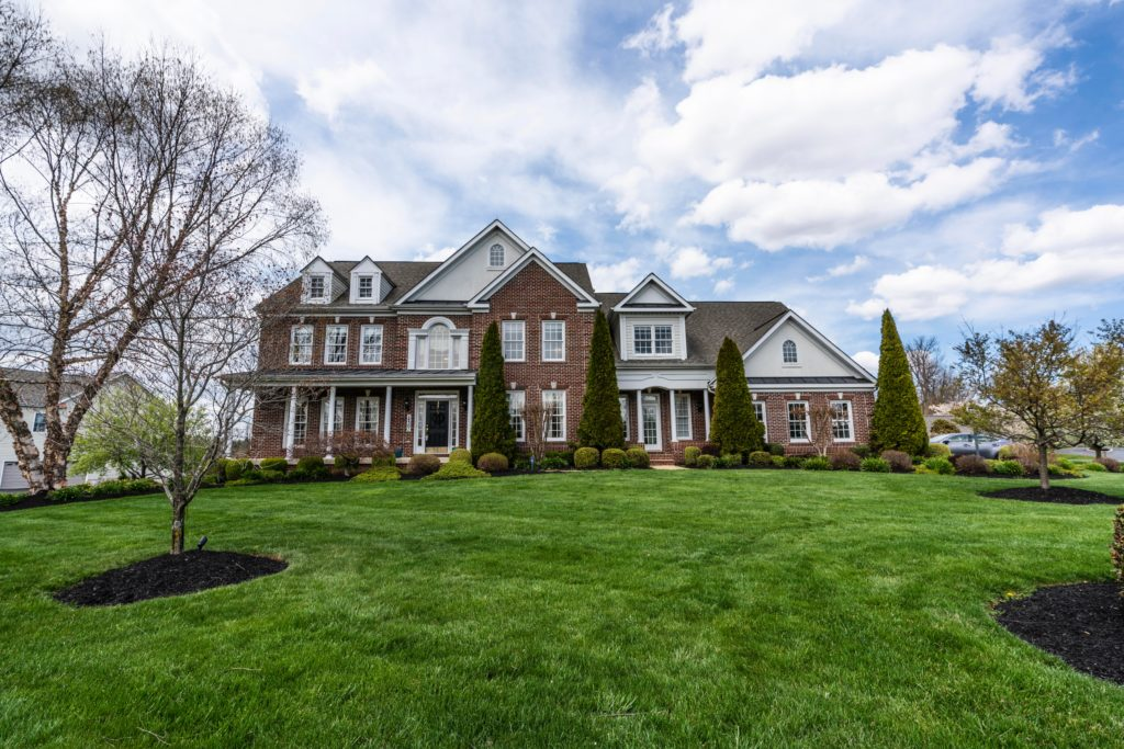 Suburban two story home with green front lawn